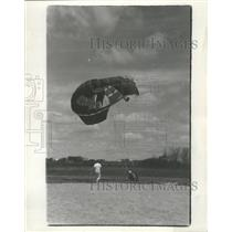 1966 Press Photo Ground Person Runs To Help Sky Diver Who Just Landed On Ground