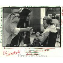 Press Photo Sandra Meche attends to Lucille Dimmen- Kenner Adult Day Care Center