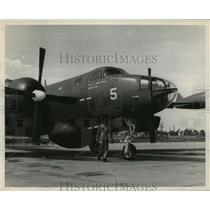 1954 Press Photo Man beside hurricane hunting plan in Texas - hca35673