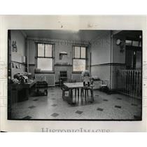 1972 Press Photo Doll Sits on a Tabel Inside Empty Room - RRW64511