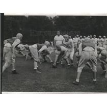 1953 Press Photo Coach Don Fleming trains Don Bosco High School football team