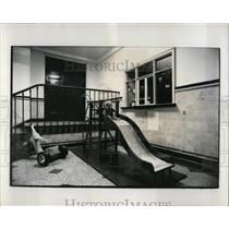 1972 Press Photo A Doll On An Empty Slide In A Playroom - RRW64509