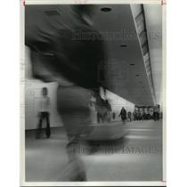 1976 Press Photo People walking in corridor at Houston Intercontinental Airport