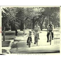 1979 Press Photo Charles and Pat Burlin bike with son Rodney on Tanglewood