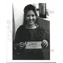 1992 Press Photo Victoria Cantu of Houston holding winnings from Texas Lottery