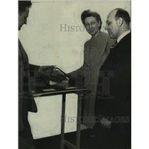 Press Photo Two Men and Woman Stand Around Table - abna45430