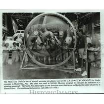 Press Photo Multi-Axis Chair Simulates Spacecraft - U.S.Space Academy for Adults