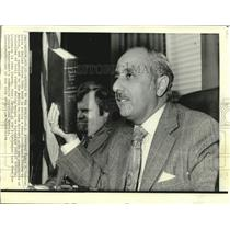 1974 Press Photo U.A. Attorney James Gabriel with code book at news conference