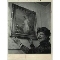 "1974 Press Photo Mrs. James Lloyd holds painting of her as young girl, ""Millie"""