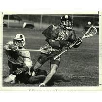 1991 Press Photo Saratoga Lacrosse player #38 catches ball as Colonie defends