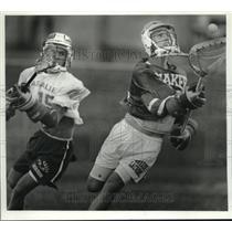 1991 Press Photo Shaker Lacrosse goalie #25 catches the ball near LaSalle #15