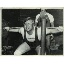 Press Photo Weightlifter James Tomaski grimaces as he attempts to lift barbell