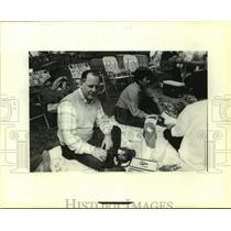 1990 Press Photo Troop Founder and Scout reunion organizer Bert Madere relaxing