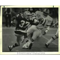 1987 Press Photo New Orleans Saints and Tampa Bay Buccaneers play NFL football