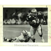 1988 Press Photo New Orleans Saints football player Craig Heyward vs. Oakland