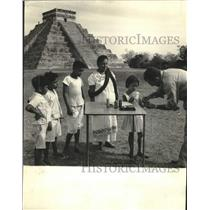 1962 Press Photo A doctor takes blood from a Mayan family at Chichen-Itza palace