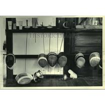 1979 Press Photo Face masks and weapons use in fencing are displayed.