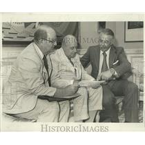 1977 Press Photo Men discussing direct air service between New Orleans and Paris