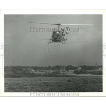 1989 Press Photo Helicopter sprays for mosquitoes in Houston area - hca47182