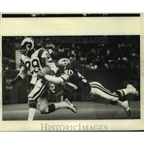 1980 Press Photo New Orleans Saints Ernie Jackson Takes Down Rams Player