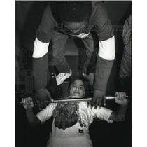 1991 Press Photo Conrad Clark helps Juan Torres work out at Hilton Youth Center
