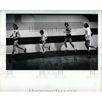 1980 Press Photo south field athletes jog run suite