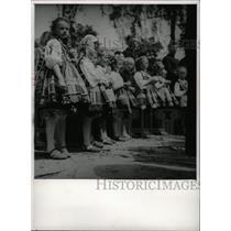 1957 Press Photo Poland people Children Row Click Snap - RRW96677