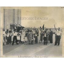 1958 Press Photo Welcoming party waves Ghanaian and US flags.
