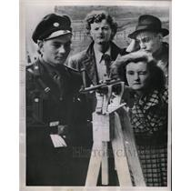 1953 Press Photo Iron Curtain communist girl rifle aim - RRX72531