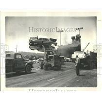 1965 Press Photo Auto Bulls Carried Into Incinerator