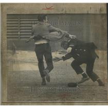 1966 Press Photo Policeman Tackling Rogue Falcon Fan Pittsburgh Game - RSC27157