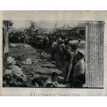 1960 Press Photo Runaway bus strewed these bodies
