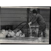 1916 Press Photo Tim McGrath Stops Water Flooding Home.