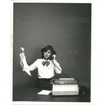 1980 Press Photo Woman Typewriter Phone Spray Bottle - RRW47261