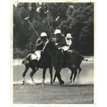 Press Photo two men ride horses play polo