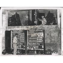 1951 Press Photo Elevator Control Panels Worker Repair