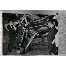1958 Press Photo Mrs.Carlos Garcia Christens Gift Plane - RRW05945
