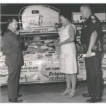 1963 Press Photo Publicity Stunts:  A driver sealed aut