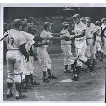 1957 Press Photo Congratulating a home run hitter  - RSH22291