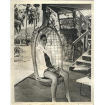 1965 Press Photo Swinging Basket Chair Little Dix Bay Resort In Virgin Islands