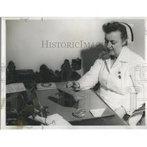 1952 Press Photo Mrs. Evelyn Madden At Desk