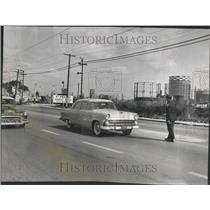 1955 Press Photo Bruno Szarley Trafic Officer Cars Road