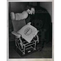 1939 Press Photo Reporter Examines Life Belt Aboard Passenger Plane