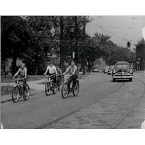 1951 Press Photo Family Rides Bike Down Street - nea41899