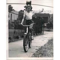 1951 Press Photo Dorothy Klamer Riding Bicycle Using Hand Signals Properly