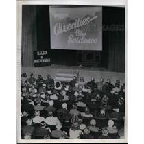 """1945 Press Photo Civilians in Germany watching the film """"Village of Hate"""""""