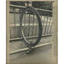 1972 Press Photo Lone Wheel Left On Bike Rack - RRT38719