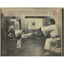 1976 Press Photo Little Karate Boy Kick Breaks Board