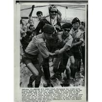 1966 Press Photo Scouts carry Ky across muddy field