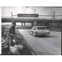 1961 Press Photo Highway Engineer Watching Traffic
